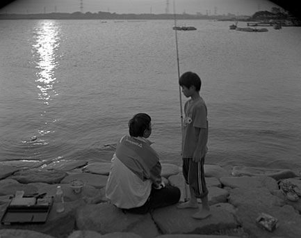 Father and son fishing, evening at lake Teganuma, Abiko