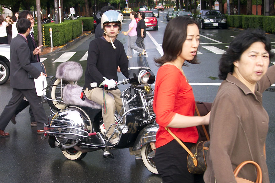 Vespa driver on a restored machine, spotted in Ebisu, a part of Tokyo